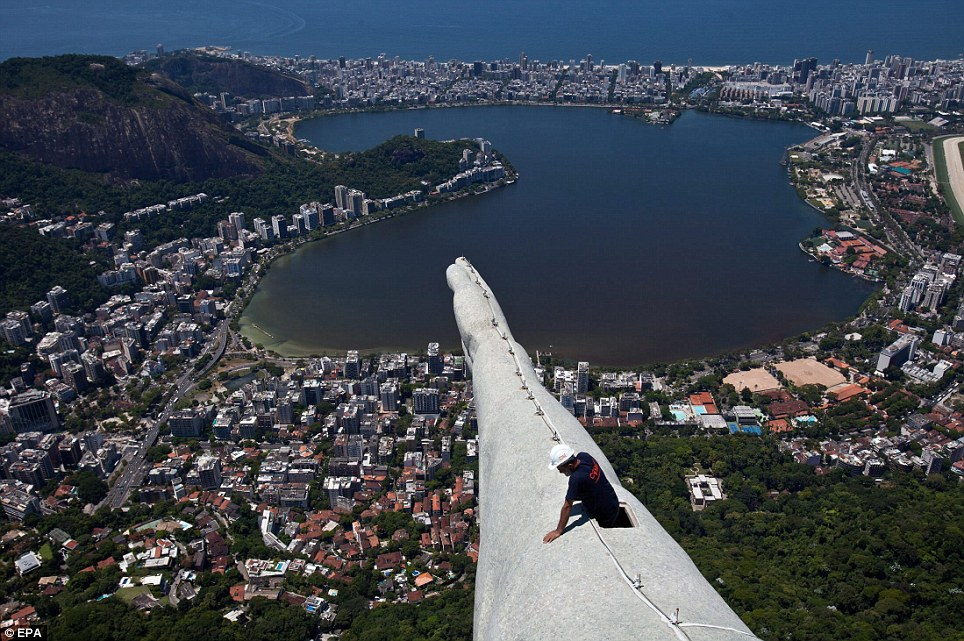 A Construction Worker Carrying Out Repairs on the Arm of Christ The Redeemer