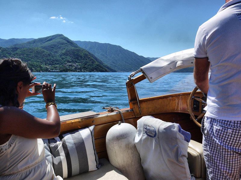 Nat Taking a Photo of Lake Como From the Boat