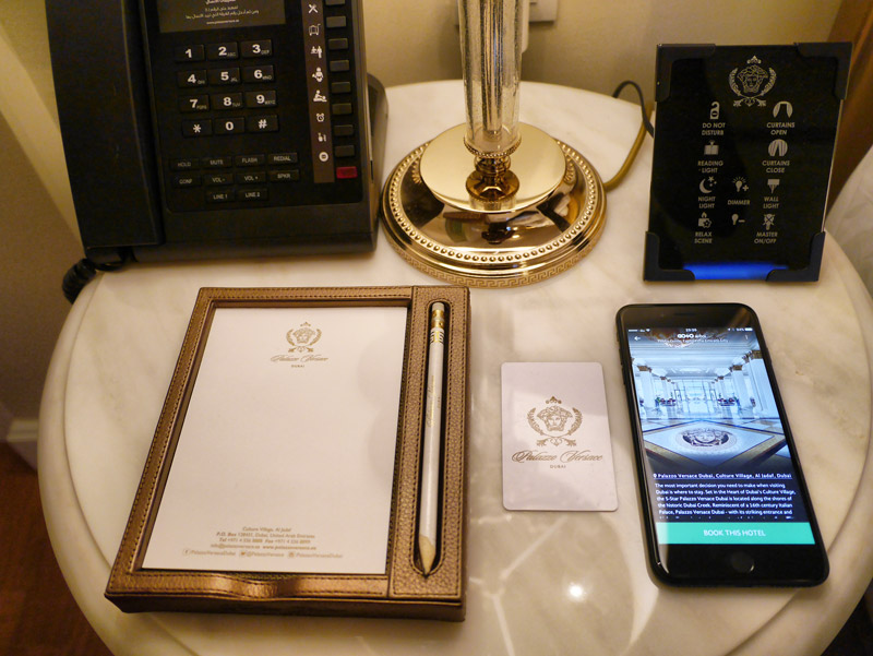 A Designer Bedside Table: Versace Pencil, Paper Pad, Room Key, Lamp and Room Controls