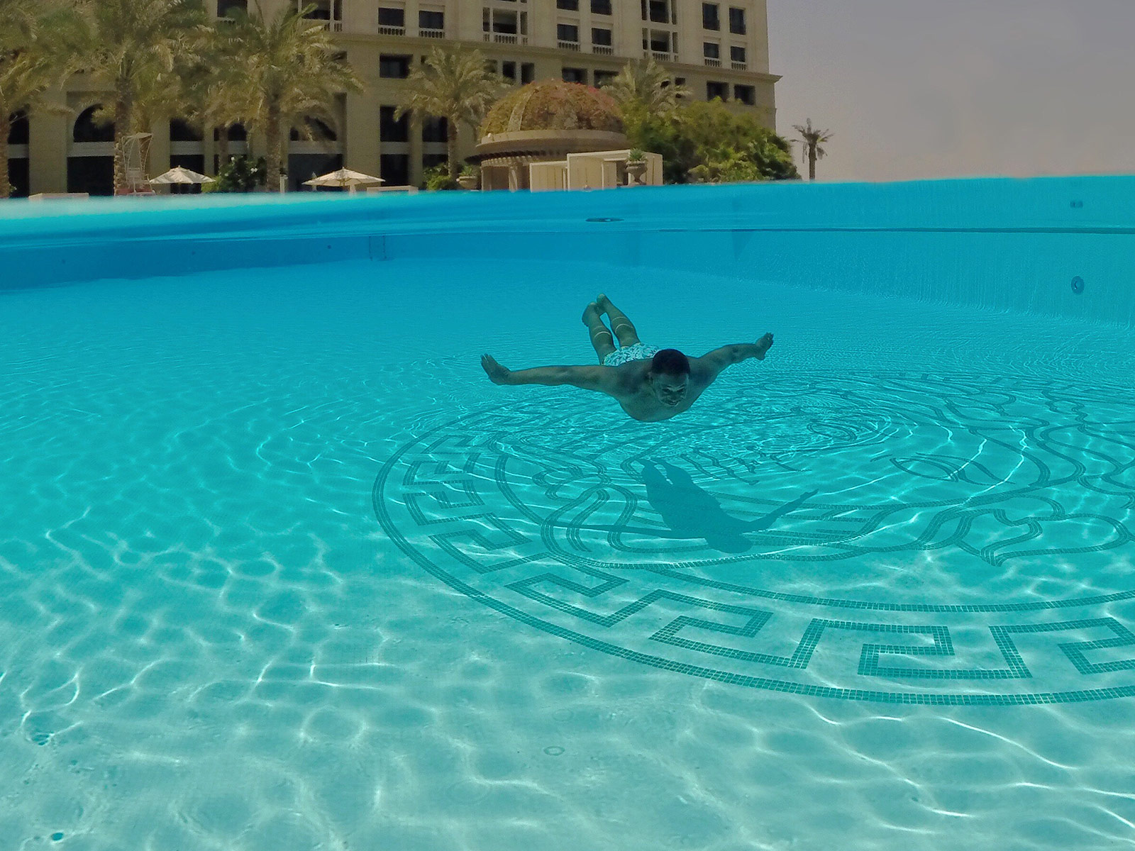 Mase Swimming Over Medusa in the Main Pool at Palazzo Versace Dubai