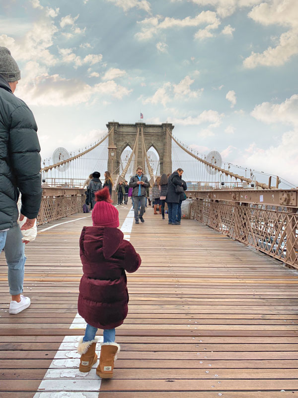 Let's Get This Party Started! Our Toddler Daughter Getting Ready to Walk Across Brooklyn Bridge