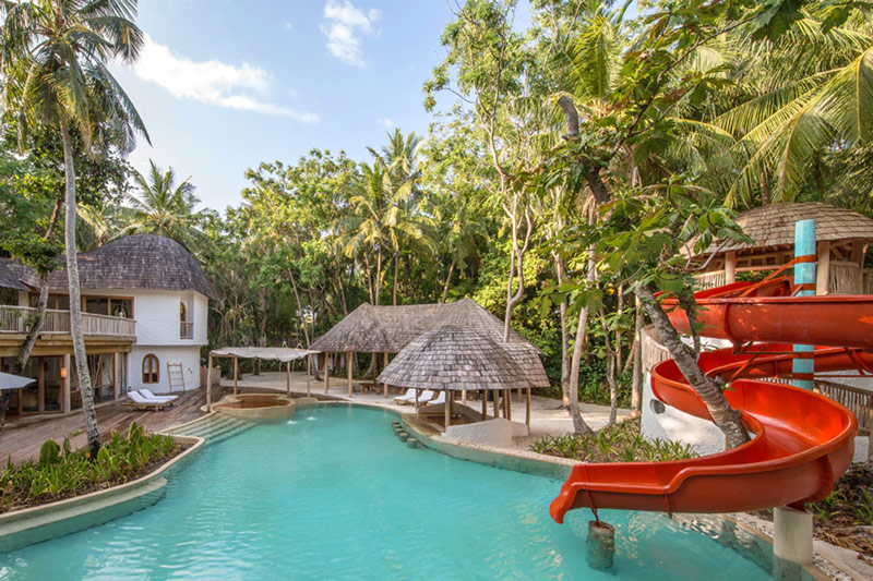 Soneva Fushi's Children's Pool at The Den Kids Club - Complete with a Spiralling Red Water Slide!