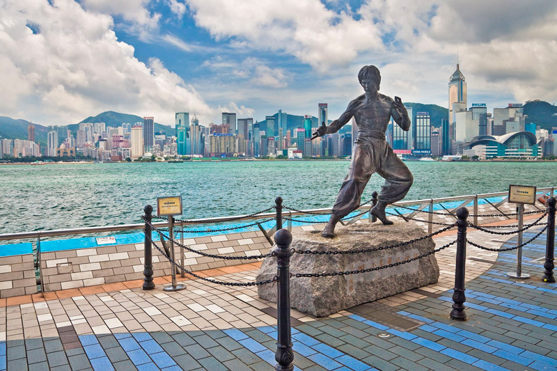 The Bronze Bruce Lee Statue on the Victoria Harbour Waterfront at the Avenue of Stars - Tsim Sha Tsui, Kowloon, Hong Kong