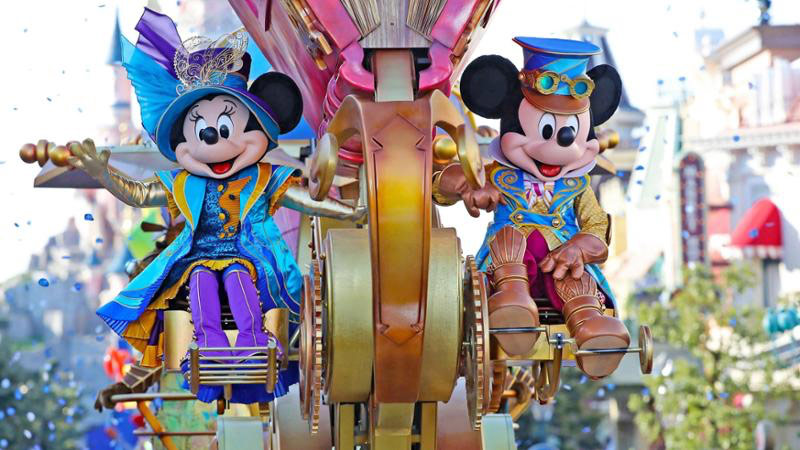 Minnie Mouse and Mickey Mouse Cycle Through Main Street USA in True Disneyland Parade Fashion