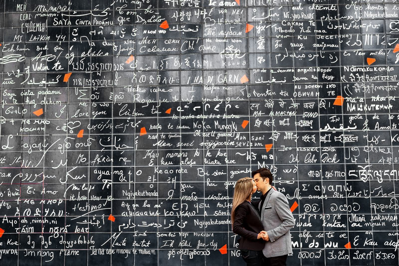 Kissing at the Wall of Love in Montmartre, Paris