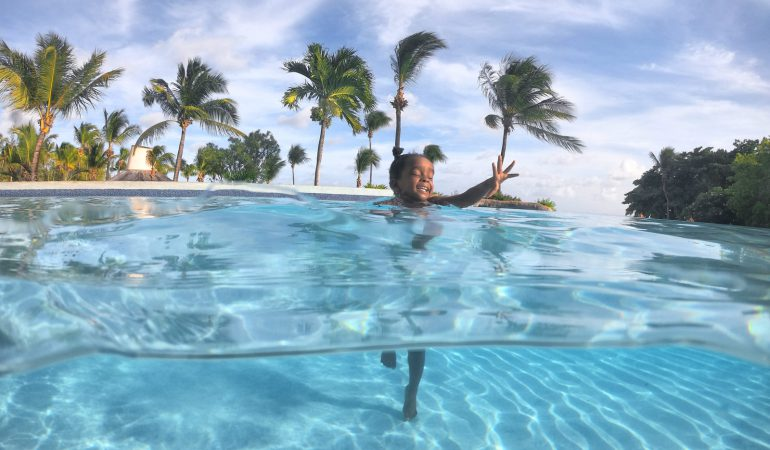 Girl in Swimming Pool at the Hilton Barbados Resort Hotel