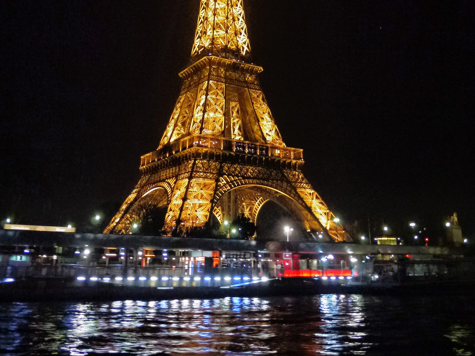 The Brightly Illuminated Eiffel Tower at Night - Paris, France